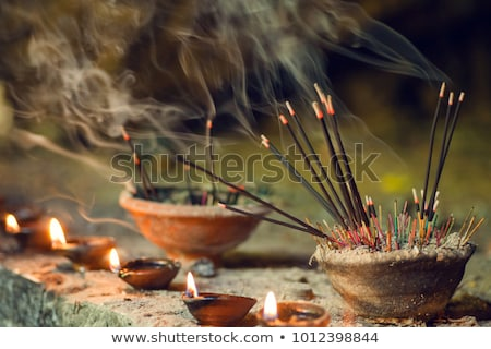 Burning aromatic incense sticks. Incense for praying Buddha or Hindu gods to show respect Stock photo © galitskaya
