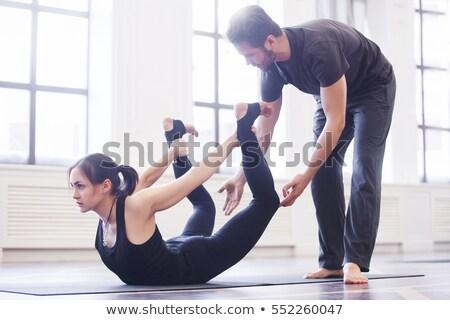 помочь инструктор активный соответствовать девушки йога Сток-фото © pressmaster