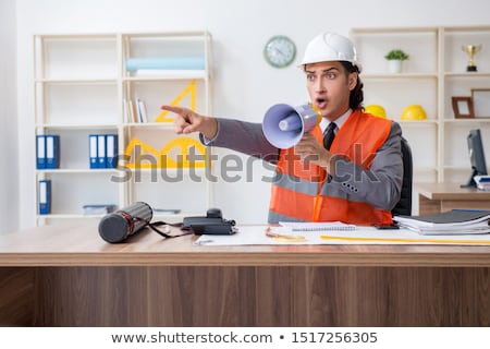 Young architect yelling with megaphone  Stock photo © ra2studio
