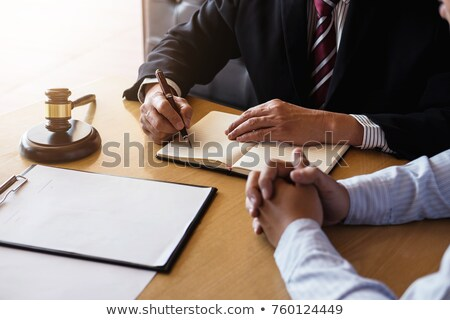 close up of gavel male lawyer or judge working with law books stock photo © freedomz