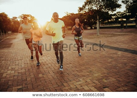 Quatro jovem masculino feminino atletas Foto stock © pressmaster