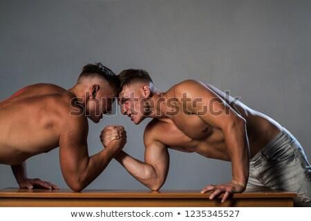 Broers arm worstelen twee home hand sport Stockfoto © Lopolo