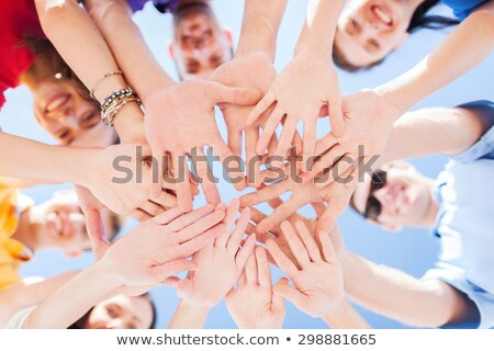 group of happy students over blue sky background stock photo © dolgachov