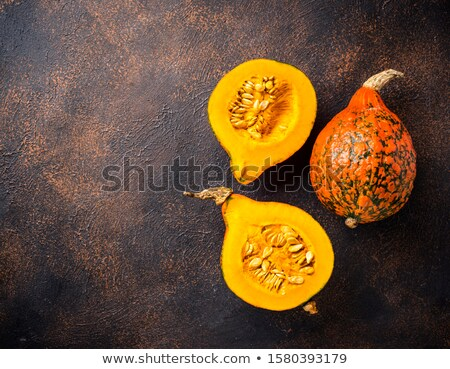 Dissected raw hokkaido pumpkin with seeds Stock photo © furmanphoto