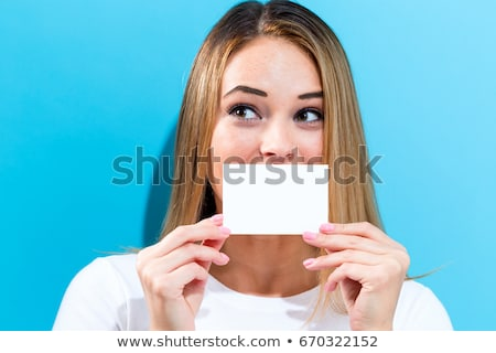 személy · tart · kártya · száj · ironikus · mosoly - stock fotó © ra2studio