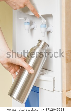 pouring water into metal bottle  Stock photo © dogbone66
