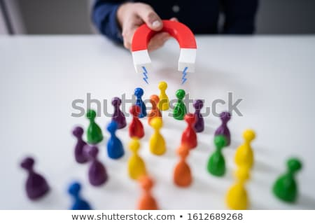 Magnet Attracting Colored Pawns Stock photo © AndreyPopov