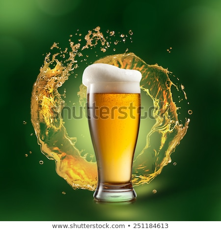 Green alcoholic drink splash in a beer mug on a white. Stock photo © artjazz