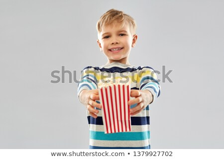 little boy holding paper bucket with popcorn Stock photo © dolgachov