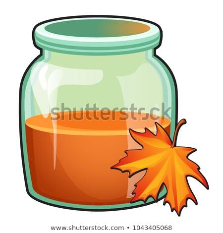 Transparente vidro jarra laranja líquido maple leaf Foto stock © Lady-Luck