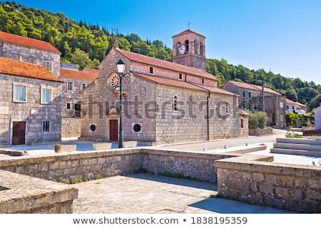 Ada pastoral taş köy kilise görmek Stok fotoğraf © xbrchx