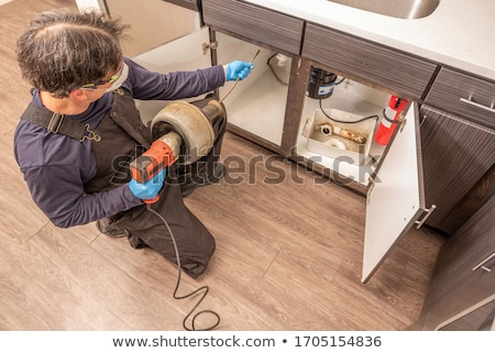 Plumber Cleaning Drain Stock photo © AndreyPopov