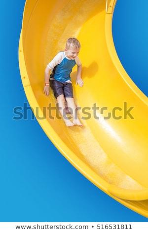Sonriendo equitación abajo amarillo tobogán Foto stock © galitskaya