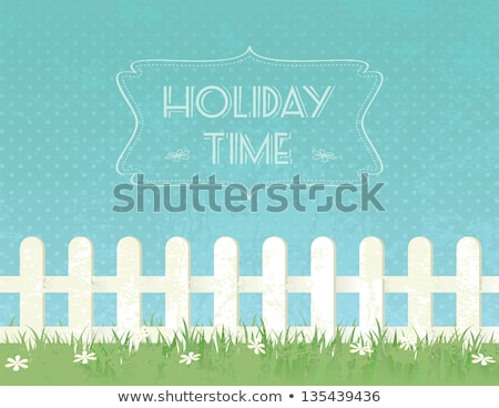 Blue sky background with decorative picket wooden fence and grass. Garden fencing, summer backyard Stock photo © robuart