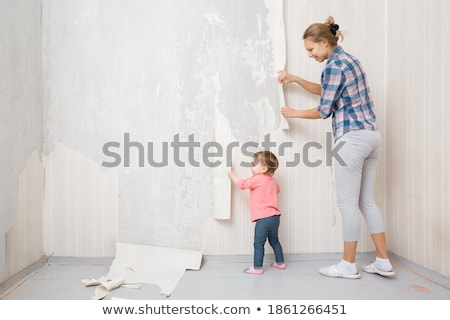 children help mother remove  from wall old wallpapers Stock photo © Paha_L