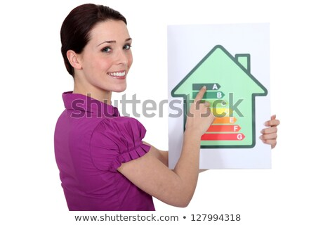 woman with a house energy rating sign stock photo © photography33
