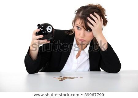 Jeunes désespérée femme tirelire table costume Photo stock © photography33
