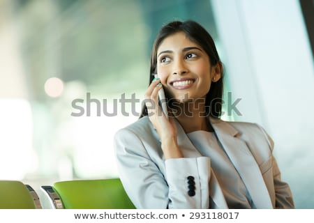 asian indian business woman talking mobile phone stock photo © lunamarina