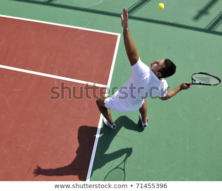 Young man outside a tennis court Stock photo © photography33