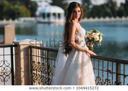 Divatos fiatal lány rózsa haj mosolyog kamera Stock fotó © stockyimages