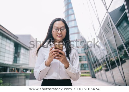 entrepreneur using a cellphone outside a mirrored building stock photo © photography33