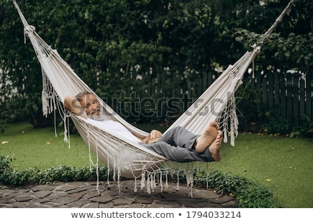 portrait of a man in a hammock Stock photo © photography33