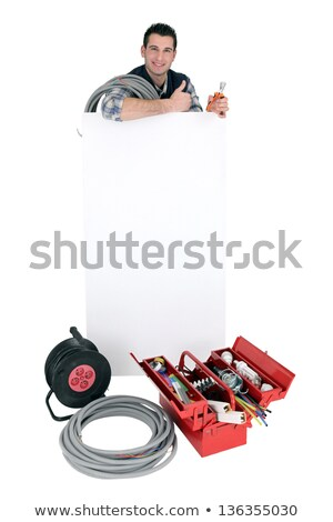 Laborer standing behind white sign for message Stock photo © photography33