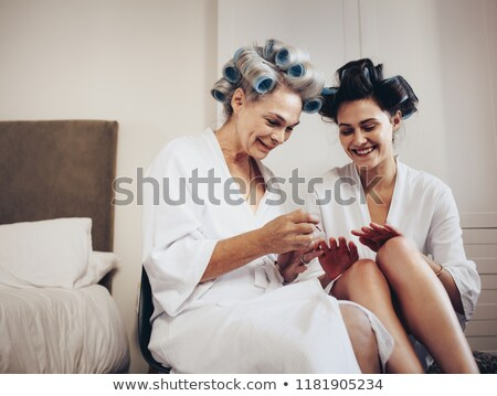 Elderly woman with her hair in rollers Stock photo © photography33