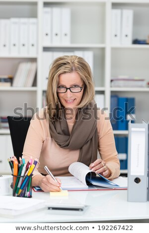 woman peering over her glasses stock photo © photography33