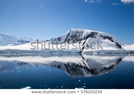 Tükröződés hegyek tenger hó hideg sarki Stock fotó © timwege