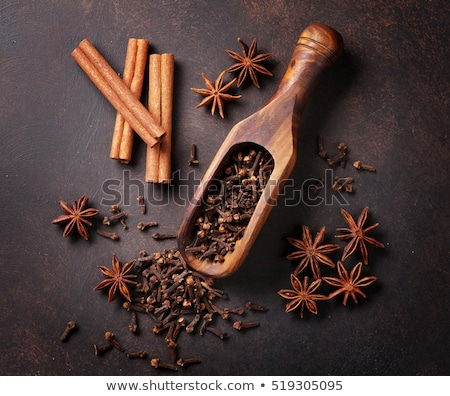 Star Anise and Cinnamon Sticks on Wooden Table stock photo © maxpro