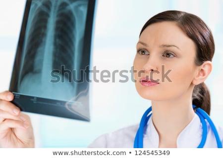Femenino médico mirando torso Xray feliz Foto stock © HASLOO