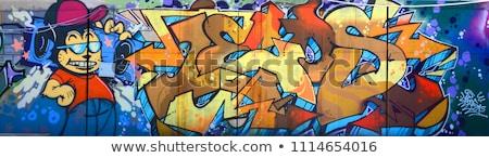 Stok fotoğraf: Sokak · duvar · yazısı · renkli · sprey · boyalı · tuğla · duvar