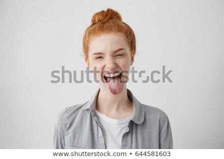 Huncut tini kifejező arc flörtölő fiatal Stock fotó © stockyimages