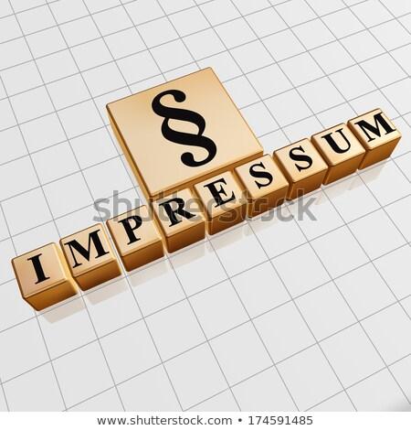 impressum and paragraph sign in golden cubes Stock photo © marinini