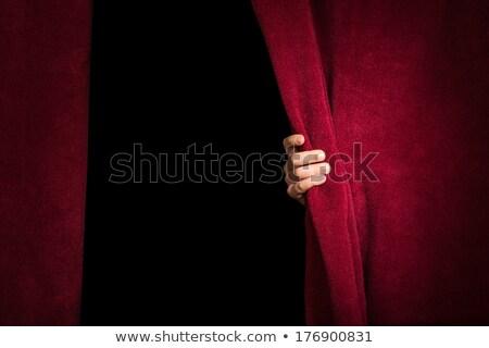 Hand appearing beneath the curtain. Stock photo © deyangeorgiev