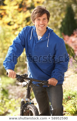 portrait of young man with cycle in autumn park stock photo © monkey_business