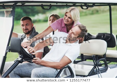 Couple Riding In Golf Buggy On Golf Course Stock photo © monkey_business
