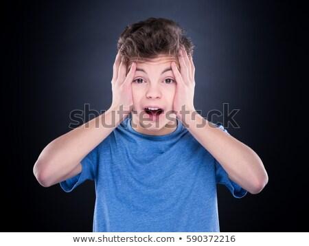 Caucasian teen boy screaming. Stock photo © iofoto