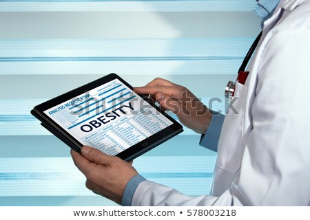 overweight on the display of medical tablet stock photo © tashatuvango