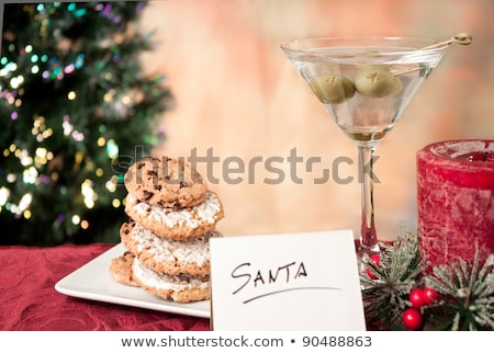 Christmas card from Christmas trees with Santa Claus and gingerbread toys. Stock photo © mcherevan