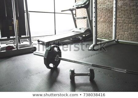 Heavy barbell in empty room Stock photo © wavebreak_media