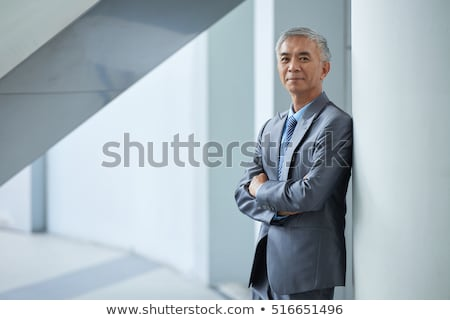 Asia · hombre · de · negocios · sonriendo · retrato · aislado - foto stock © elwynn