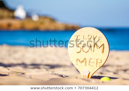 Racket in the sand of the beach. Summertime. Crete, Greece. stock photo © ankarb