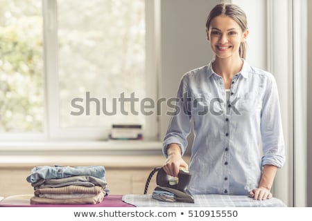 young woman ironing. Stock photo © vystek