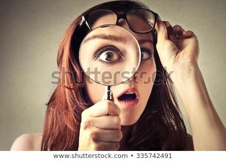 nieuwsgierig · vrouw · naar · vergrootglas · jonge · vrouw · meisje - stockfoto © stevanovicigor