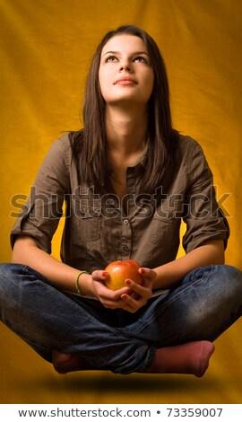 Yoga levitatie appel mooie jonge brunette Stockfoto © lithian