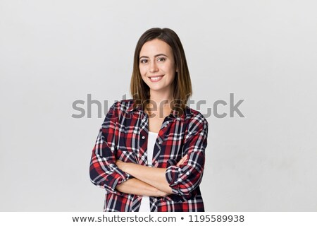 Woman in checkered shirt with arms crossed Stock photo © deandrobot