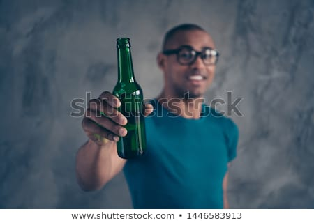 Close-up of man's hand holding glass of beer Stock photo © deandrobot