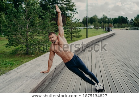portrait of a healthy shirtless sportsman standing outdoors with water stock photo © deandrobot